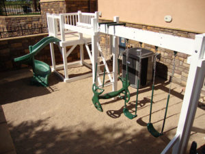 Vinyl play structure with swing set and slide