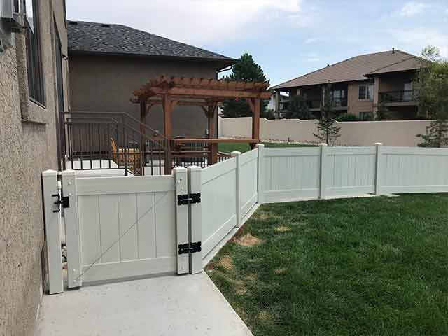 Three foot vinyl privacy fence with walk gate