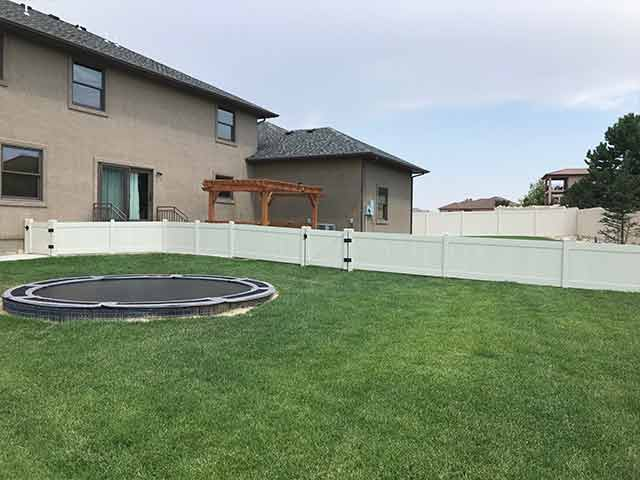 Three foot vinyl privacy fencing with 2 walk gates