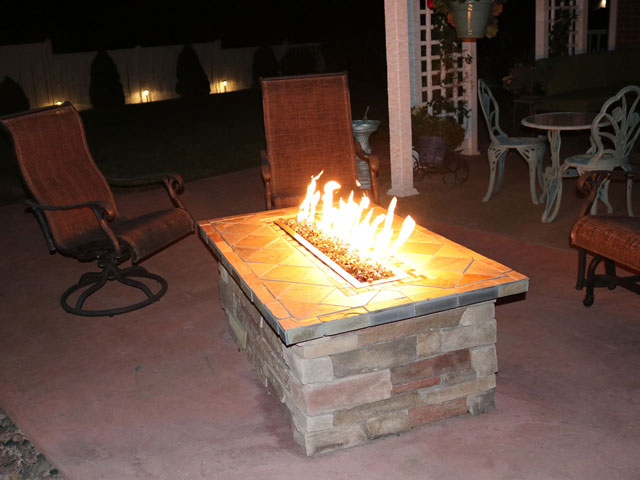 Rectangular stone and slate gas fire pit with fire glass