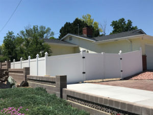 Solid vinyl privacy fence with double drive gate