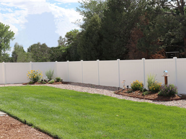 Solid white vinyl privacy fencing